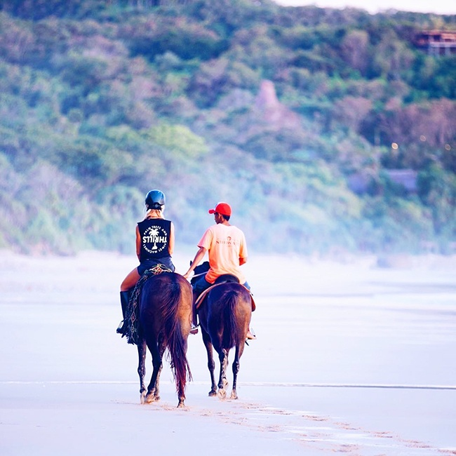 Rebecca-gawthorne-riding-a-horse-on-a-beach