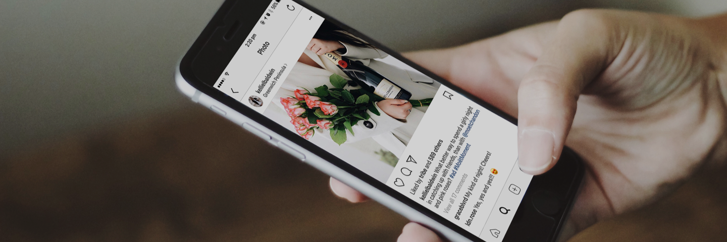 influencer-scrolling-through-instagram-on-iphone-banner-image