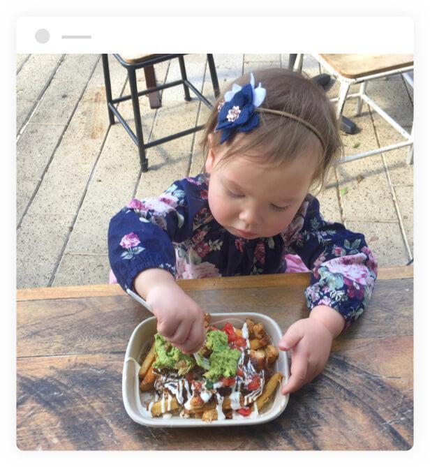 Kid eating at Guzman Y Gomez