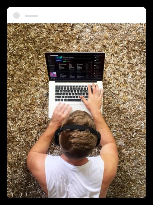 man using spotify on his laptop
