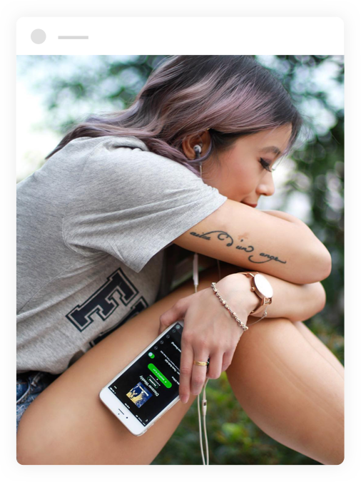 woman using spotify app on mobile