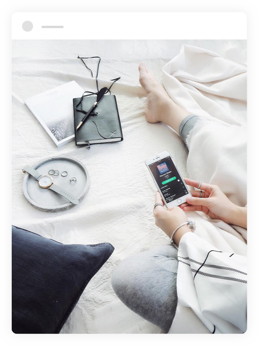 woman using spotify app on iphone