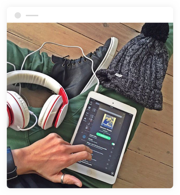 woman listening to spotify on a tablet