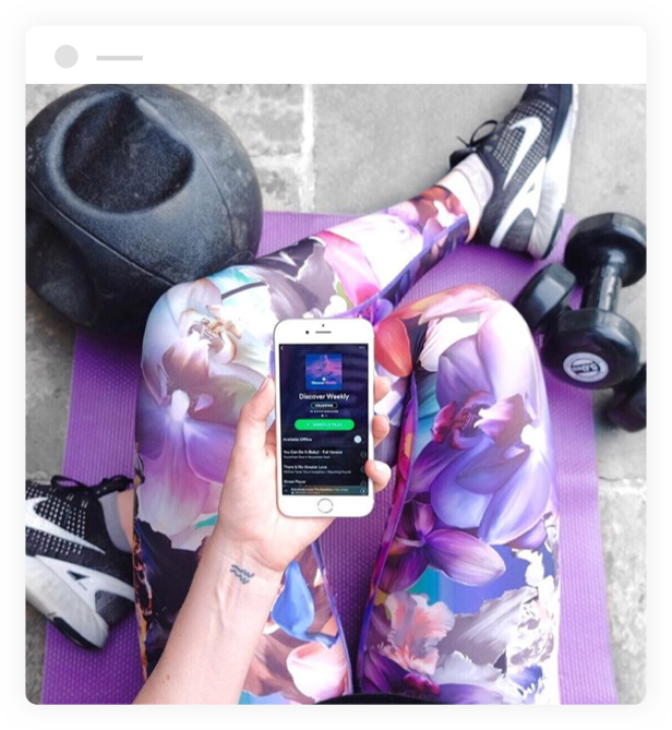 woman using spotify app at the gym