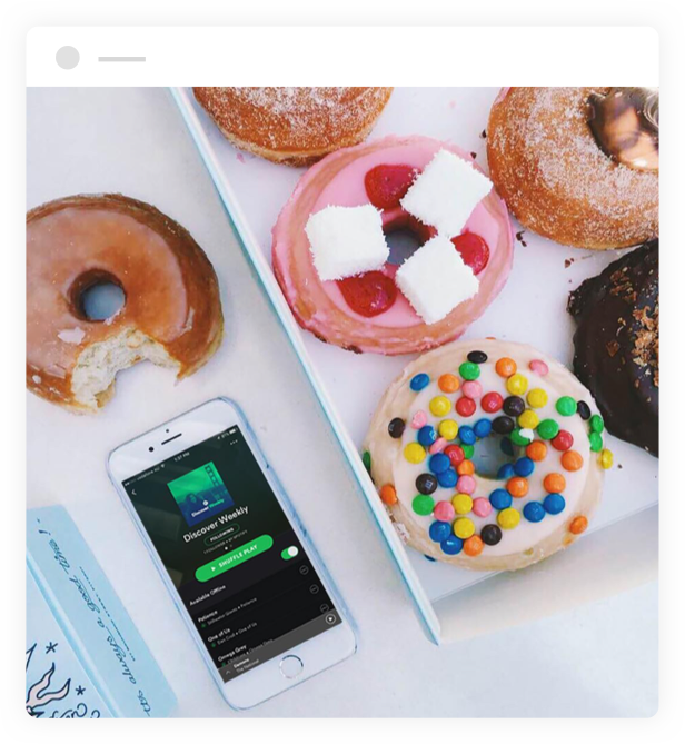 spotify app on a mobile next to donuts